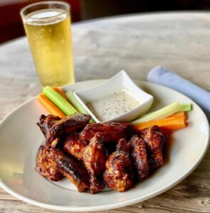 wings, ranch, carrots, celery, and beer
